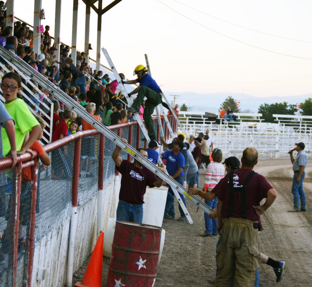 Fire departments from all across the county scramble during the ladder race portion of the Fireman's Challenge during the Sanpete County Fair on Saturday, Aug. 20. In the end, the Wales and Manti fire departments each won three challenges. The Manti department was the winner of the final challenge.