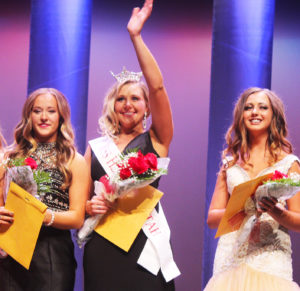 Manti native Bailey Simons waves after being crowned Miss Heart of Utah at the Sevier Valley Center in Richfield on Saturday. To the left is her first attendant, Keaten Mickelsen of Salina. To the right is the second attendant, Marissa Richardson of Nephi.