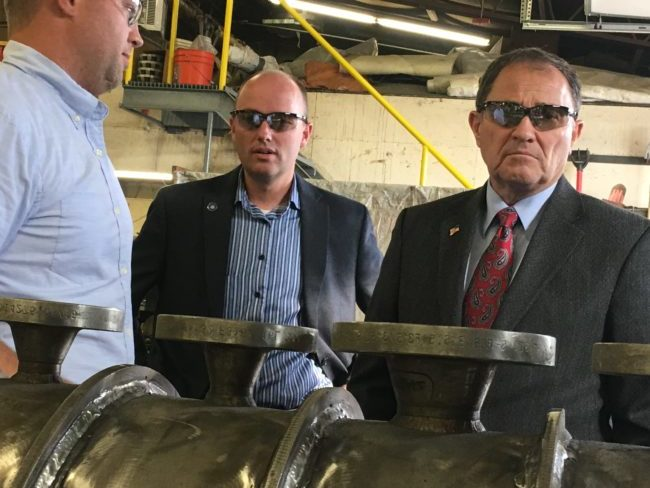 Governor Gary Herbert stands with the staff of Barclay Mechanical in Manti. Herbert (pictured slightly right) toured the facility alongside John Barclay (right side, back row), co-owner, last Thursday during a campaign visit. - Matt Harris / Messenger photo