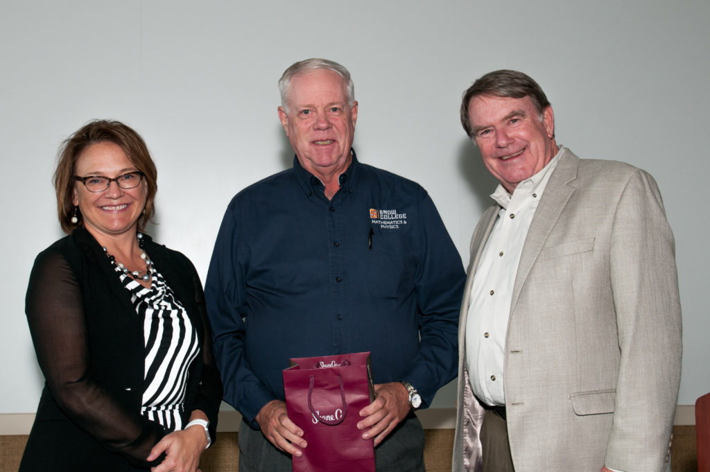 Ted Olsen (center) holds an award for 35 year of service on the board of the Utah Association of Municipal Power Systems (UAMPS). On his left is current UAAMPS board chairwoman Jackie Flowers, and on his right, Douglas Hunter, the operation's general manager.