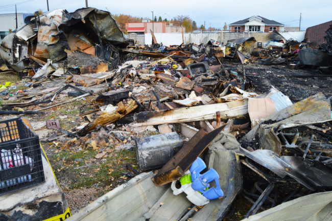 An infant potty-training seat is one of the few items that is still identifiable in rubble left after fire destroyed two homes in a mobile home park on Main Street in Ephraim on Friday afternoon. Families living in the homes lost everything they owned.