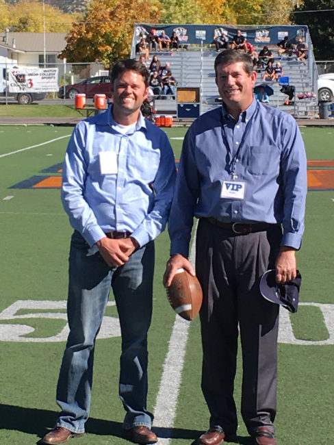 Justin Osmond (left) and Charles Pugh appear at halftime at the Snow College homecoming game, where they received distinguished alumni awards. - Matt Harris / Messenger photo
