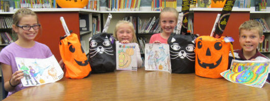 From left to right are the winners of the Manti Elementary school coloring contest; Ella Clark, Madison Cox, Laynee Pace and Collin Quayle. - Daniela Vazquez / Messenger photo
