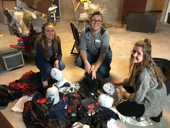 "Members of the Snow College Residence Hall association make preparations for the upcoming ""Scare at the Square Halloween"" event. - Matt Harris / Messenger photo"