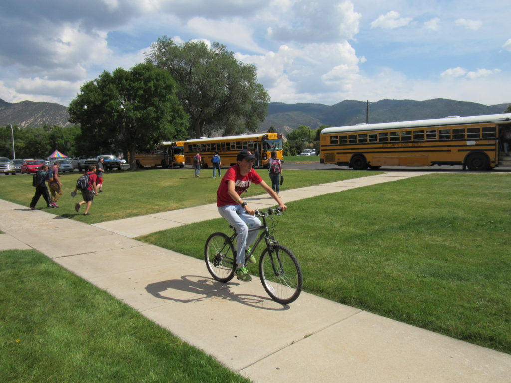 Manti High students board buses, ride bikes and walk home after the bell dismisses them for the day.