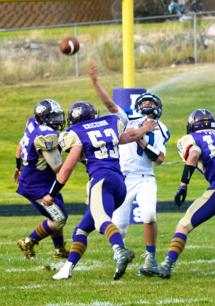 Gunnison Valley High's quarterback Kris Edwards sends a pass flying during the Bulldogs' 40-6 victory against the Wayne Badgers.