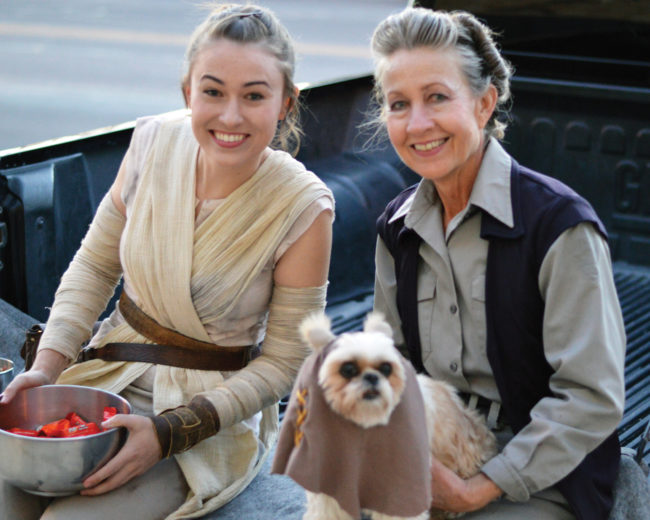 "Kate and Susan Murdoch (holding dog) are both garbed in spot-on Star Wars regalia and accompanied by their Ewok ""Missy"" during Manti's Trunk or Treat event on Monday - Robert Stevens / Messenger photo"