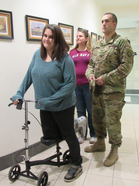 Mikayla Hill of Moroni, who is 18, didn't let reconstructive surgery on her foot keep her from casting her first vote. She wheeled into the county courthouse Tuesday on a scooter device along wither her parents, Alicia and Bob Hill. Voter turnout in the county as a whole was 81 percent. - Suzanne Dean / Messenger photo
