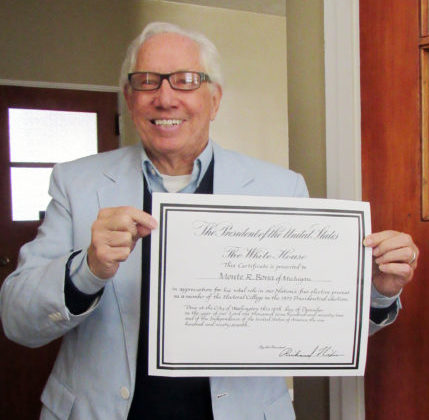 Monte Bona of Mt. Pleasant holds a certificate signed by President Richard Nixon recognizing him as a member of the Electoral College in 1972. Bona, 79, says citizens concerned about the state of electoral politics in 2016 should look through the lens of history.