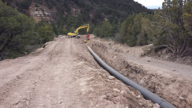 Alpha Engineering opted to lay their water pipeline down the middle of the existing road to preserve the environment during their project to bring green power to Sanpete County.