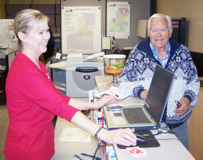Clerk Selma Jorgensen helps Gary Christensen of Ephraim get his ballot to vote on Tuesday at the Sanpete County Clerk's office in Manti - Lloyd Call / Messenger photo