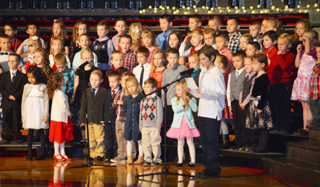 "Covin Keeler, fourth-grader at Manti Elementary, opened up schools Christmas program on Monday evening at Manti High. The show began with kindergarteners sharing a message about giving by singing ""The Very Best Part of Christmas."" - Daniela Vazquez / Messenger photo"