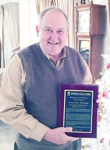 Leonard Blackham, former state senator and commissioner of agriculture, displays a plaque recognizing him as a member of the Horne School of Music Hall of Fame at Snow College.