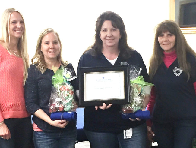 The team that intervened when a young man put his arm through a window causing life-threatening bleeding. From left are Trina Johnson, RN, of the Emergency Department at Sanpete Valley Hospital; Rosa Bowles, Kari Lewis and Liz Reams, all EMTs with the North Sanpete Ambulance Association.
