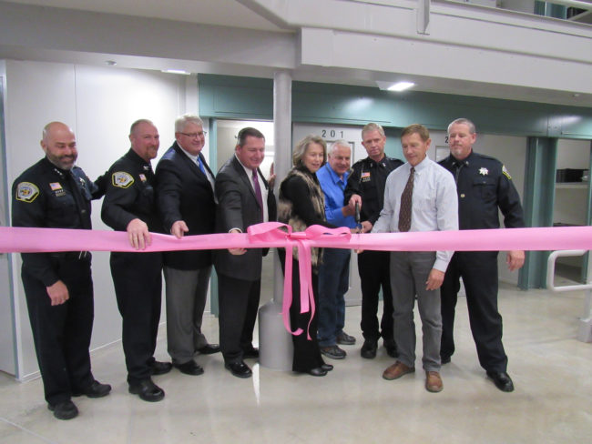 Participating in ribbon cutting for new $31 million unit at the Central Utah Correctional Facility (CUCF) are (L-R) London Stromberg, director of operations, Utah Department of Corrections; Shane Nelson, deputy warden at CUCF; Bruce McDonough, vice president, Layton Construction; Rep. Darrin Owens, who represents Sanpete County in the Utah Legislature; Sanpete County Commissioner Claudia Jarrett; Commissioner Scott Bartholomew; Steve Turley, director of the Division of Special Projects for the Utah Department of Correction; Gunnison Mayor Bruce Blackham; and Chuck Bigelow, CUCF warden. - Suzanne Dean / Messenger photo