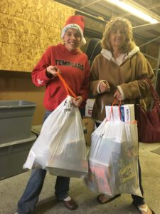 Vivianne Leers, daughter of Sanpete Humanitarian Council Board Member Jeana Cheney, was one of many volunteers to serve at the annual Sub for Santa at Snow College West Campus in Ephraim on Saturday, Dec. 10.