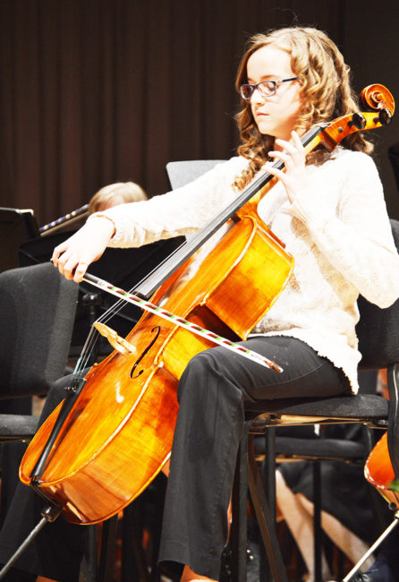Katelyn Nordfelt, a seventh-grade band student, played the cello as part of Ephraim Middle Schools Candlelight program on Wednesday, Dec. 7, at the Snow College Eccles Center for the Performing Arts. - Daniela Vazquez / Messenger photo