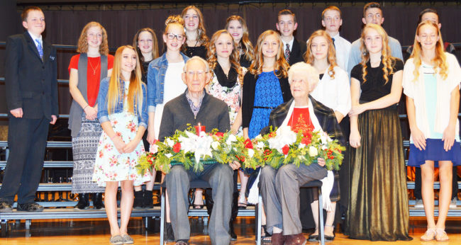 Ephraim Middle School honor students presented Vern Buchanan (front left) and Marge Anderson (front right) with wreathes and lighted candles representing years of dedicated humanitarian and community service. Honor students, standing on the back row from left to right, are Gavin Watkins, JoLee Gillett, Erin Frischknecht, Lucy Eddy, Libby Simons, Josh Larson, Cole Nielson, Grady Thompson and Jason Nelson. Students in the center row, from left to right, are Sierra Roberts, Emma Jorgensen, Alexis Naylor, Allie Bridges, Bethany Malone, Rawlee Mickelson and Camien Pritchard. - Daniela Vazquez / Messenger photo