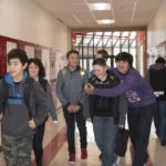 """Gear Up Coordinator, Heather Haffen led North Sanpete Middle School eighth-graders down the freshman hall, some for the first time, during the first ever """"Hawk for a Day"""" program. Some high school kids greeted the young students with a friendly embrace. - Daniela Vazquez / Messenger photo"""