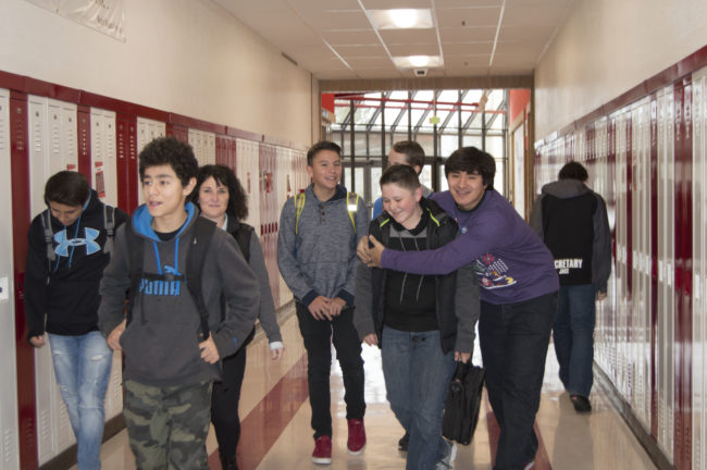 "Gear Up Coordinator, Heather Haffen led North Sanpete Middle School eighth-graders down the freshman hall, some for the first time, during the first ever ""Hawk for a Day"" program. Some high school kids greeted the young students with a friendly embrace. - Daniela Vazquez / Messenger photo"