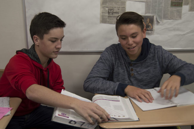 "Marcos Serrano, North Sanpete Middle School student, sits with Mason Bailey (right), North Sanpete High freshman class president, in Biology class; one of several he will attend with Mason during the schools' first ever ""Hawk for a Day"" program.  - Daniela Vazquez / Messenger photo"