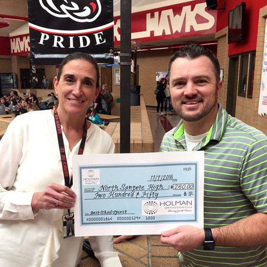 "North Sanpete High School Principal Nan Ault accepted a prize of $250 from Holman Orthodontics of Ephraim. North Sanpete won the award for ""Best School Spirit."""
