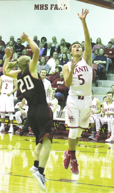 Matt Nelson (5) scores a lay up with Brock Bailey (20) defending in Manti's win over North Sanpete. Nelson came off the bench to lead the Templars with 15 points. - Bob Bahlmann / Messenger photo