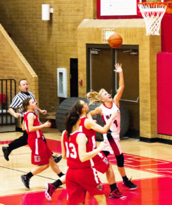 Senior forward Angela Clayton goes to the rack against Delta last Tuesday, Dec. 13. The Lady Hawks won, 43-35.
