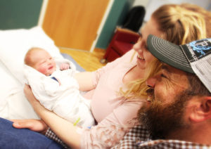Sawyer Henry Fillmore was Gunnison Valley Hospitals New Year's Baby, the first baby born in 2017. Admiring him are parents Ross and Kaylin Fillmore. - Photo courtesy Gunnison Valley Hospital