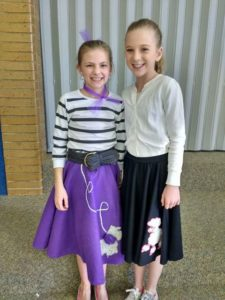 Meggan Roper (right) and Lakely Brotherson (left), sixth-grade students at Moroni Elementary, are dressed up in attire from their favorite decade, the 1950's, at last week's Red Ribbon Week.