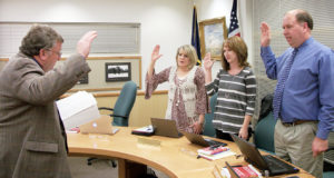 North Sanpete School District Business Administrator Darin Johansen is swearing in new board member Shalmarie Morley and incumbent members, Stacey Goble and Rich Brotherson. Brotherson will now serve as vice president in place of Greg Bailey (not pictured) who will now serve as board president.