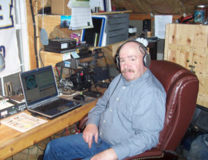 "Spencer Shields of Hideaway Valley, a member of  the Skyline Amateur Radio Club and one of the instructors for the club's  upcoming amateur radio licensing class, is seen here in his ""radio shack"" along with his radios."