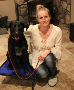 Tori Pack from Wag-N-Train Dog Rescue with Dax, a dog rescued by the organization. Wag-N-Train recently received a $5,000 grant to help fund their efforts to rescue animals.