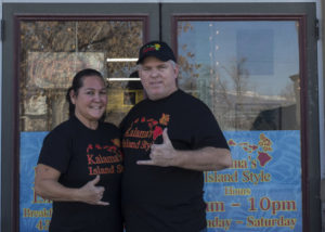 Leslie (left) and Rick Kalama show Hawaiian hand signs in front of their new eatery,  Kalama's Island Style Restaurant, which occupies the former location of Malena's Café in Ephraim.