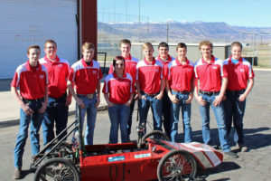 The Manti High School Greenpower Team and their two-time state champion electric car. Left to right: Jacob Johnson, Alex Stevens, James Ray, Graysen Pierson, Reid Olson, Kenyon Butler, Katelyn Dickinson and Bradon Owens. Not pictured: Brian Taylor and Ethan Larsen - Matt Harris / Messenger photo