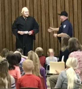 "Spring City Officer Keith Nunley defeats Voldemort ( Elijah Hancock), the third villain in the school's reading competition. Villain No. 3 has been uncovered at Spring City Elementary School. The students read their books, wrote their summaries and raced to get all the clues that, once solved, would reveal the third criminal in the theft of the Diary of a Wimpy Kid Books. The clue was, ""I have seen your heart, and it is mine, Harry Potter."" Voldemort from the Harry Potter series is Villain No. 3."