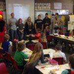 NSHS leadership students introduce the district food drive to a Spring City Elementary class. From left, high school students Jordan Henson, Mascot ( Cody Booher), Bailee Lucas, Jackson Blackhurst, Denisha Ivory, Addelyn Brotherson, Chase Bailey. Gavin Cox and Brenden Blackham. - Photo courtesy Jeff Erickson