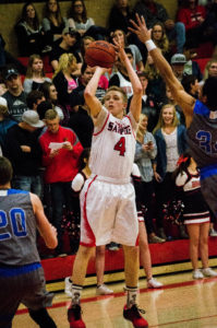 Junior Spencer Steadman goes for a jump shot over the Stansbury defense in the first round of the 3A playoffs. North Sanpete lost to the Stallions on a game-winning three-pointer, 44-43. - Kyler Daybell / Messenger photo