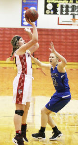 LaRieah Rosser shoots over Jerusha Miner in Manti's come-from-behind win over Gunnison. - Bob Bahlmann / Messenger photo