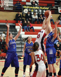 Lady Hawk Aubree Ison clashes with the Carbon coverage surrounding her during their game last Thursday. The Lady Dinos won 51-35, but the loss came on the heels of a solid 55-33 win against Canyon View just two days before. - Robert Stevens / Messenger photo