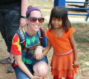 Ashley Thompson of Ephraim with a girl she met during a two-week mission to Cambodia to help victims of sex trafficking. Thompson said she saw many instances of young girls like this one being prostituted to adult white men. From that moment, she committed herself to helping fight such injustices.