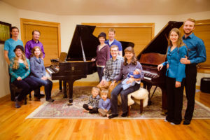 The Bastian family of Axtell has established a family tradition of musical excellence. From left to right (standing), Benjamin Bastian, Bevan Bastian, Heidi Spendlove, Mike Spendlove, Mauresa Wood and Taylor Wood. Left to right (sitting) Kalyce Bastian, Gay Bastian, Andrew Egan, Hannah Egan, Josh Egan and Jessica Egan (holding Elizabeth Egan).