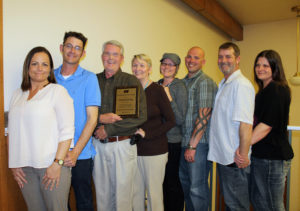"The John Keeler family of Manti celebrate after Keeler receives an award ""for distinguished leadership and service"" from the Sanpete County Farm Bureau. From left are Keeler children: daughter-in-law Mandy; son Alex; John and Diane Keeler; daughter Jessica and son-in-law Mike Warren; son Jeremy and daughter-in-law Rose Keeler. Not available for picture: son Chris and daughter Leila Keeler."