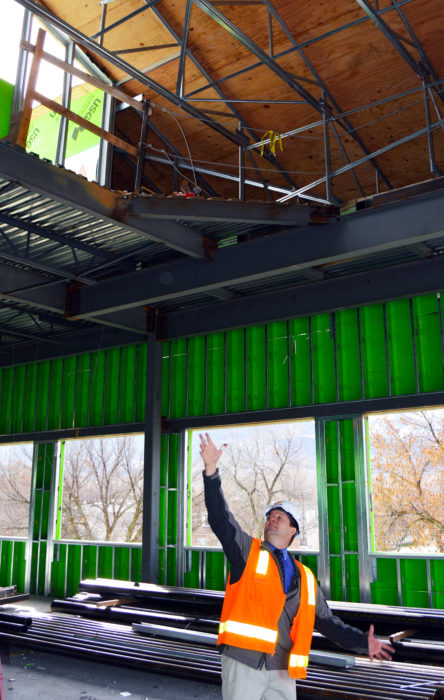 Dan Black, dean of science and chemistry, points to the planetarium under construction in the new Snow College science building.
