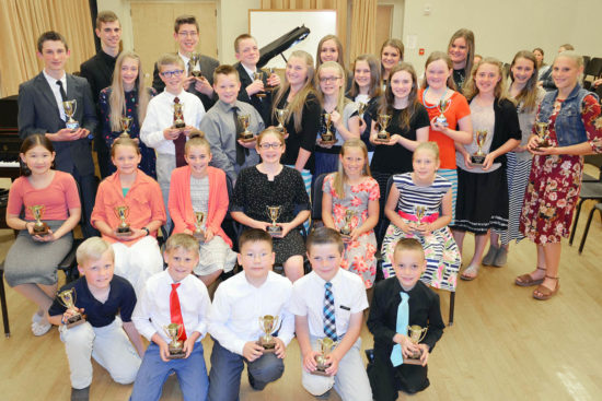 Local piano students celebrate the Gold Cups they earned this year at a recital on March 19 at Snow College's Eccles Center for the Performing Arts.