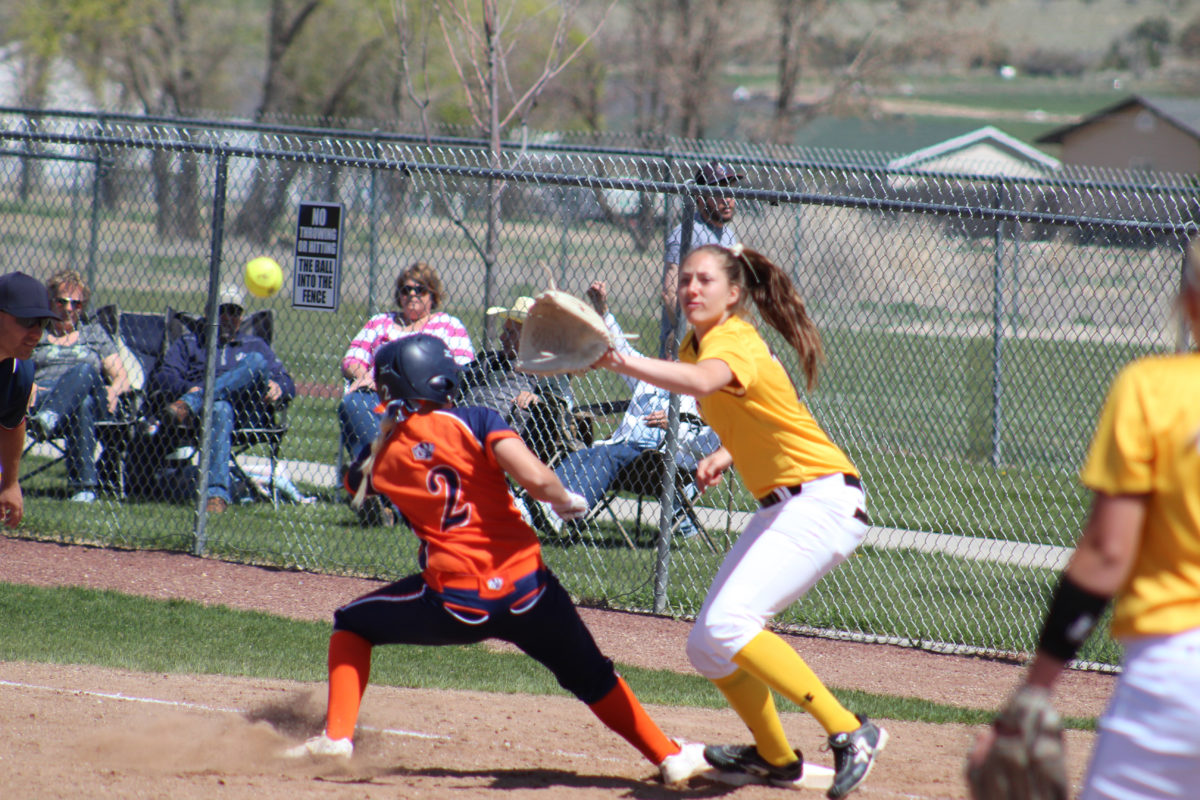 Sophomore McCall Stoddard just barely gets on base in the Lady Badgers' third game against Southern Idaho on Saturday, April 15, during a weekend series. The Lady Badgers dropped this game, 11-2, in six innings as part of a four-game sweep by the Lady Eagles.
