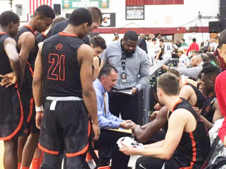 Wasatch Academy basketball players huddle up for strategy discussion during the Dick's Sporting Goods National Tournament.