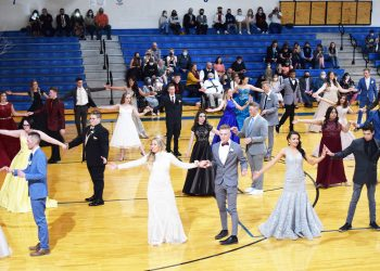 Juniors at prom perform a choreographed dance in the GVHS gym.