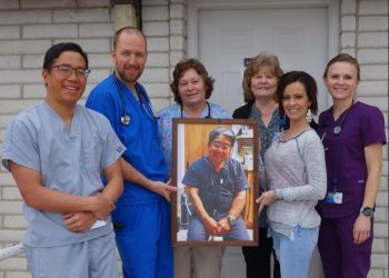 Mid Utah Family Practice staff hold a portrait of their late boss and, in one case, father, Dr. Dwight Inouye. Pictured from L-R are Dr. Jordan Inouye, physician's assistant Wade Anderson, nurse Marianne Barton, clinic manager Evlynn Peterson, secretary Jacey Crane and nurse Shelley Lund.