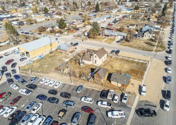 Aerial photo taken Wednesday, March 3 shows a line of cars snaking along 100 South from 300 East to the rear of the parking lot behind the Manti City Annex and South Sanpete School District. From the parking lot 	the cars pull into the rear of the Manti fire station for COVID vaccinations. About 430 people received shots in four hours.